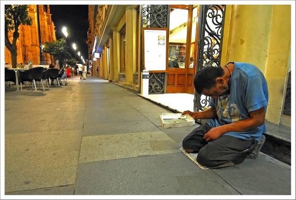 Knielende bedelaar Sevilla